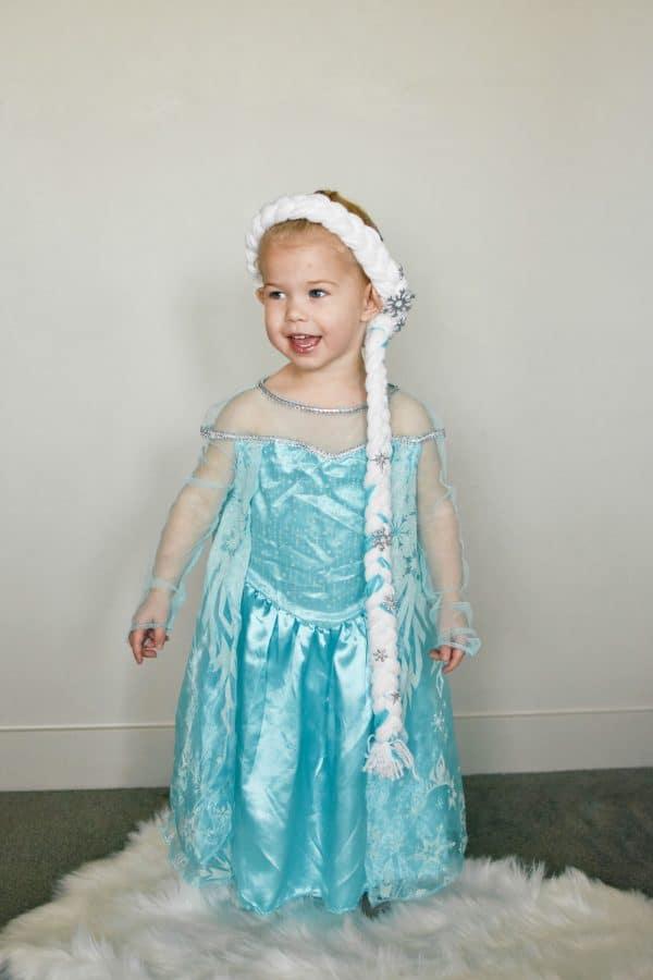 Toddler girl wears a yarn Elsa hair braid