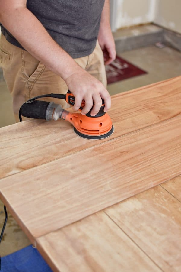 Refinishing a table with an orbital sander