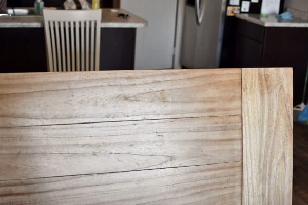 A scratched dining table that needs to be refinished