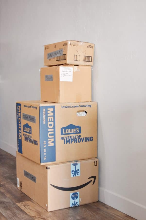 Moving boxes ready to go using the best packing and moving tips.