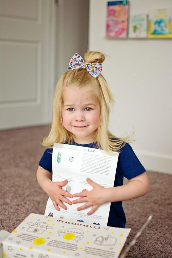 Little girl holds the Stitch Fix note from her stylist.