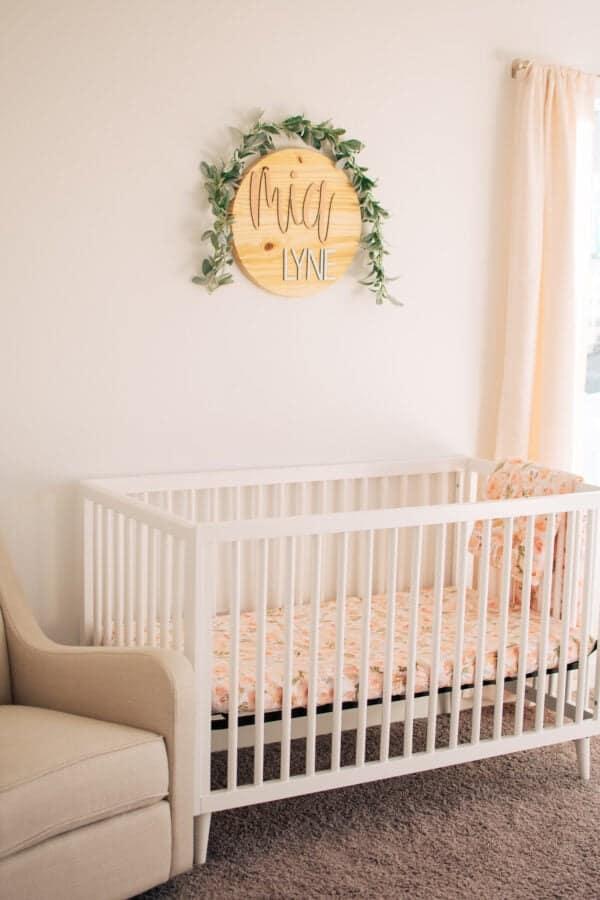 Baby girl crib and name sign.