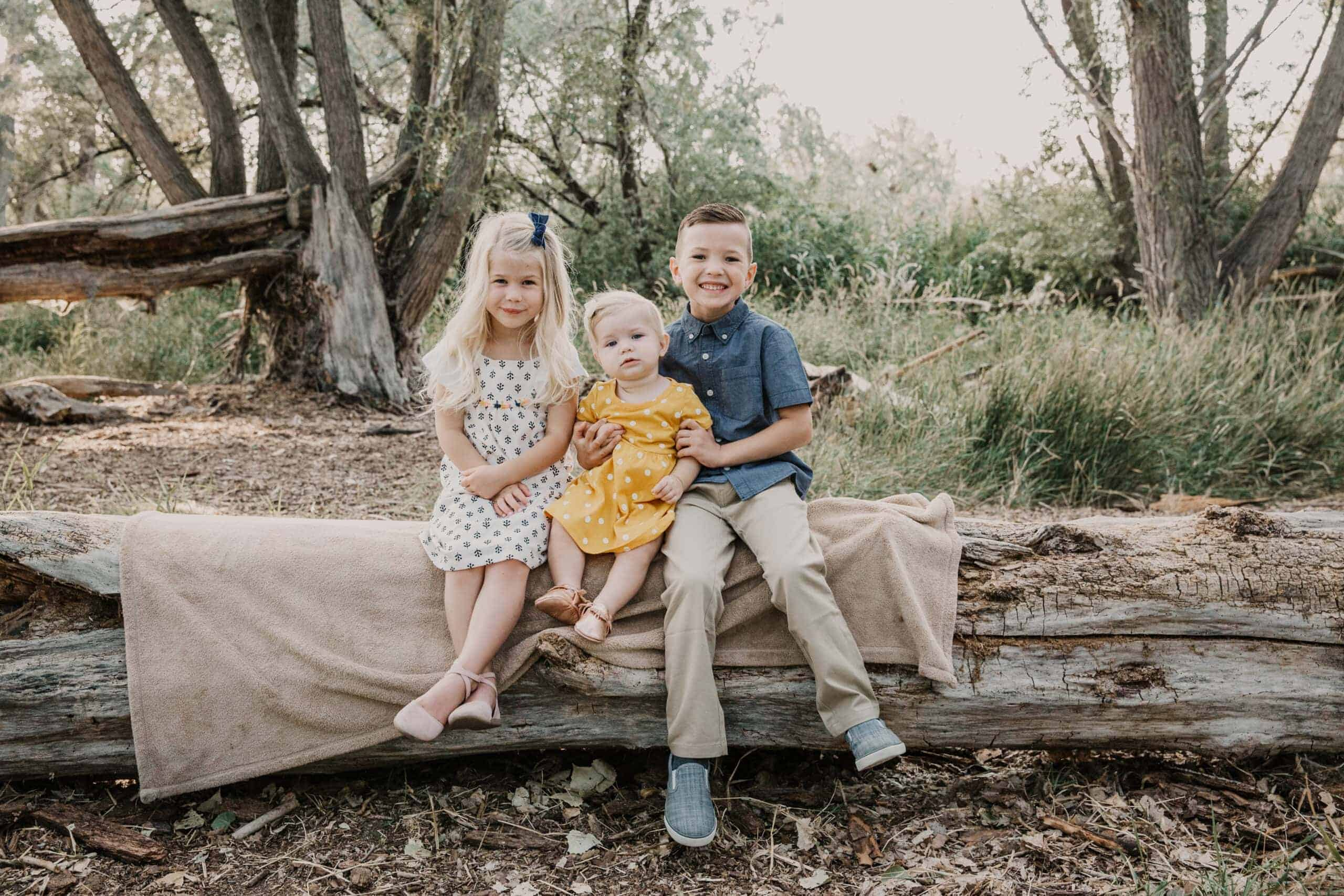 Children smile during their summer family pictures.