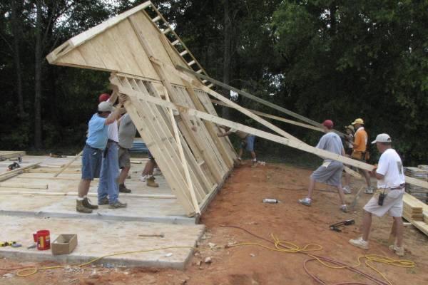 Volunteer crew raises end wall