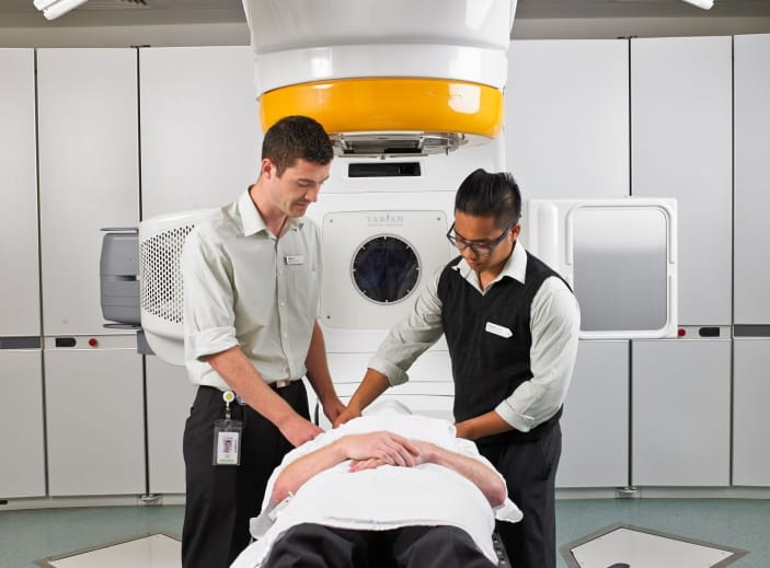 A patient is prepared for radiation therapy on a LINAC machine.