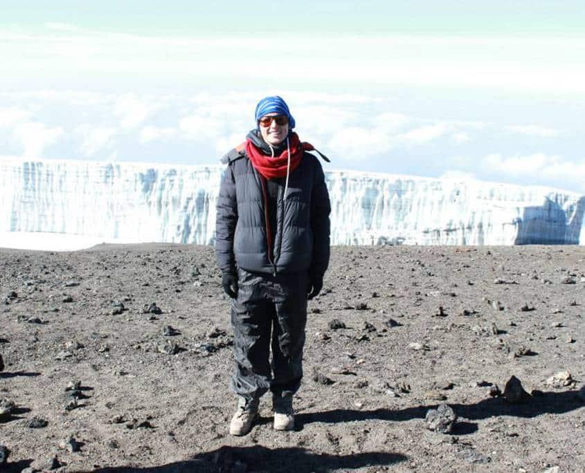 Kristen standing on the summit of Mt Kilimanajro