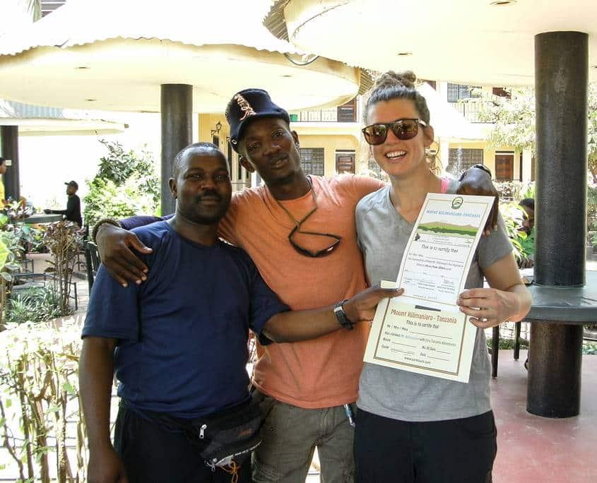 Receiving her Mt Kilimanajro summit certificate