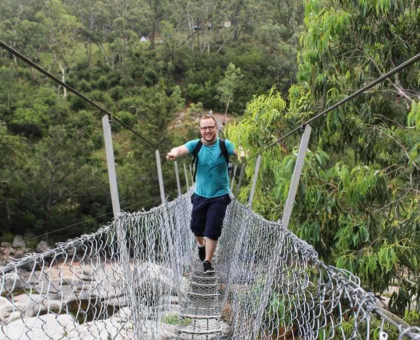 Crossing the Bowtells Swing Bridge on the 6 Foot Track