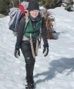 Tracey Jordan trekking through the snow on Peak Potential Adventures winter Overland Track trek through the Tasmanian Central Highlands.