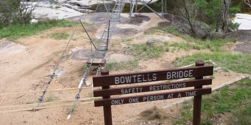 The sign as you reach Bowtells Swing Bridge on the Six Foot Track
