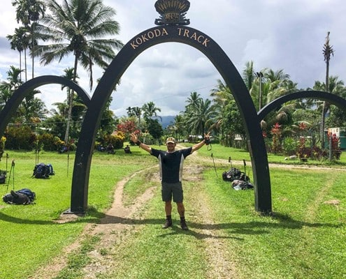 Standing under the arches at Owers Corner on the Kokoda Track