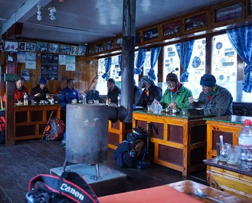 Enjoy a meal after a long day of trekking in the Himalayas