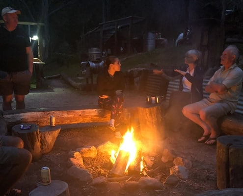 Sitting around the fire on the Six Foot Track eco lodge