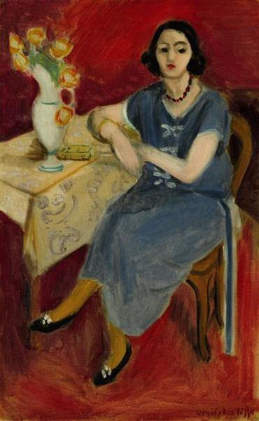 woman-in-blue-at-a-table-red-background-1923.jpg!Large