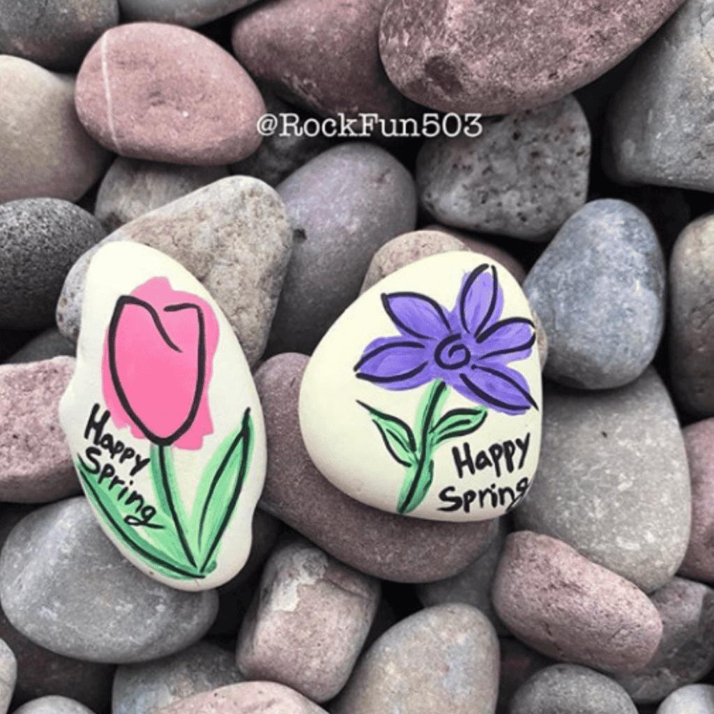 happy spring painted rocks