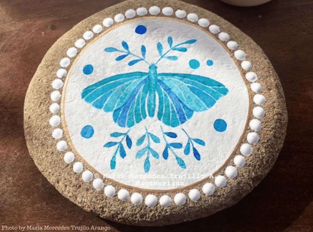 watercolor painted butterfly on a rock