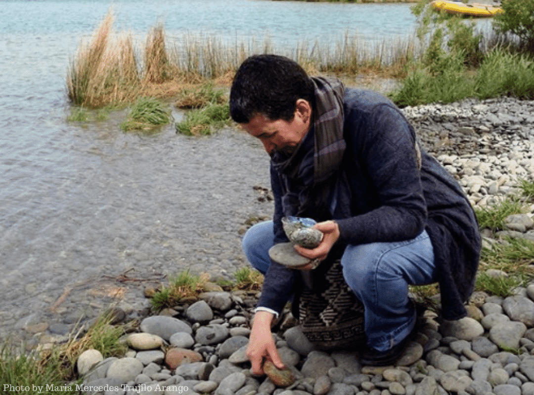 gathering stones by a lake