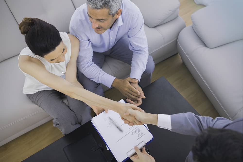 photo of an adult couple meeting with a Wills and Estate Lawyer in Edmonton for Estate Planning services