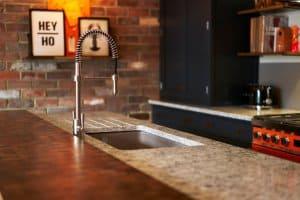 Quooker flex tap in modern, industrial kitchen