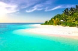 exotic beach with aqua water and white sand on a sunny day