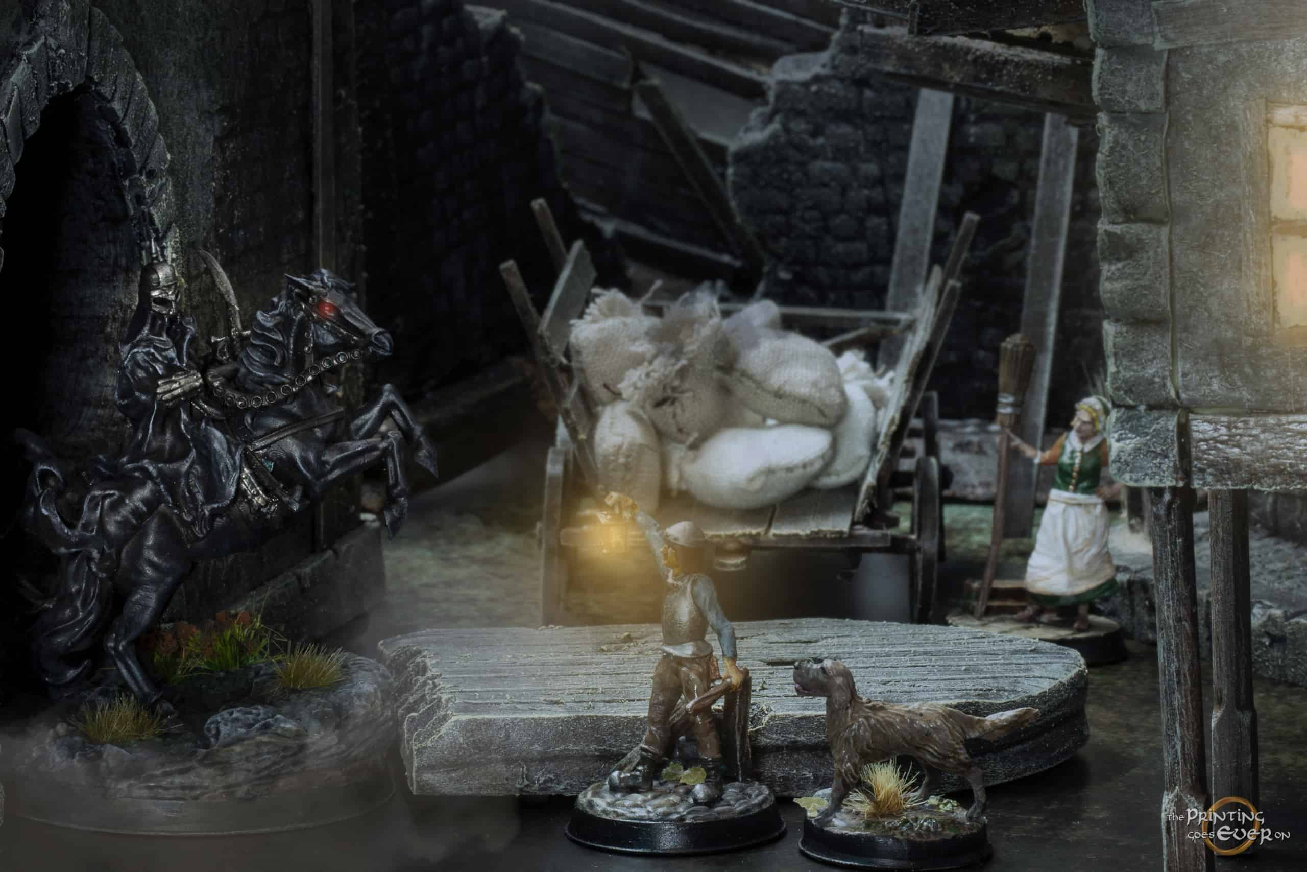 night time town scene diorama with dark rider knocking down the gate door and town guard holding his lantern up to see what is going on