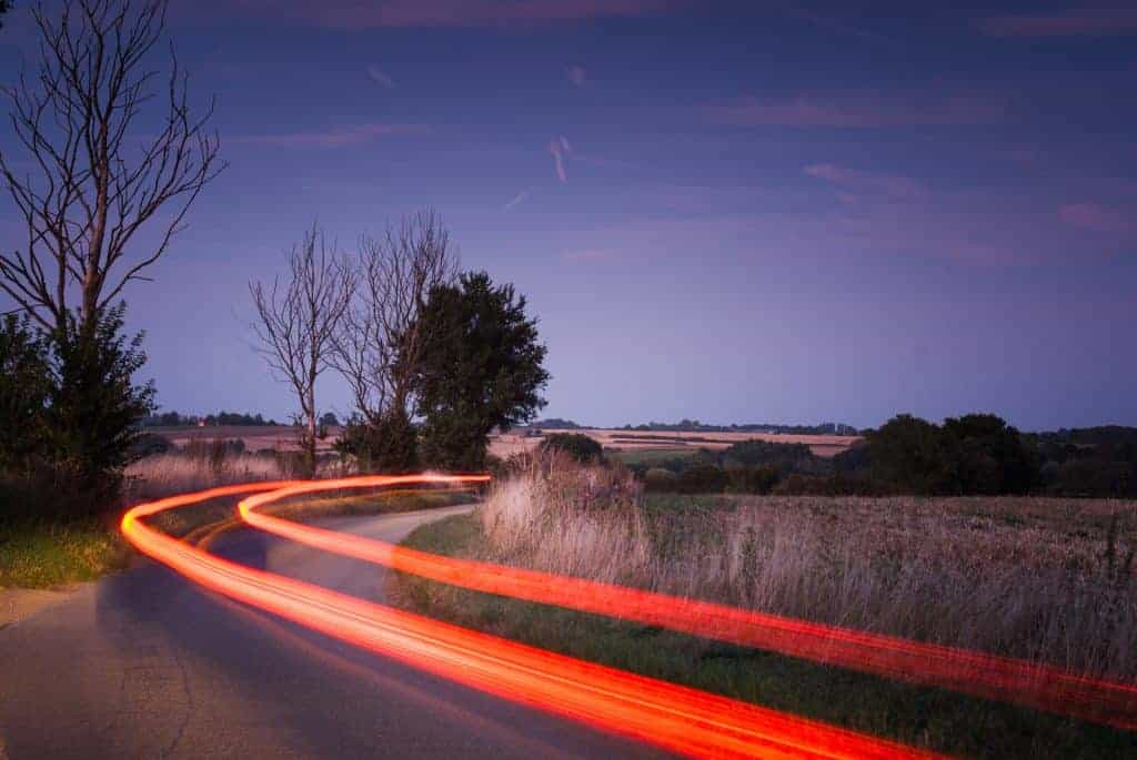 Long exposure light trails on a country lane at dusk