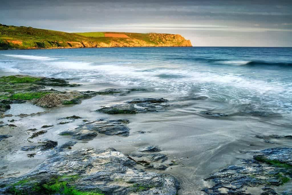 View from the beach at Gerrans Bay looking towards, Nare Head. Cornwall, England, UK