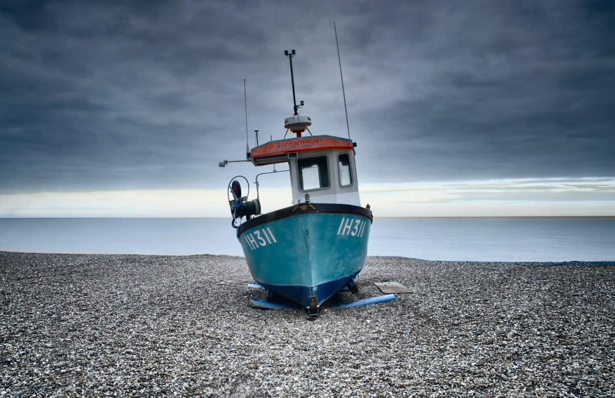 Fishing boat moored on the beach at Aldeburgh, Suffolk, England, UK