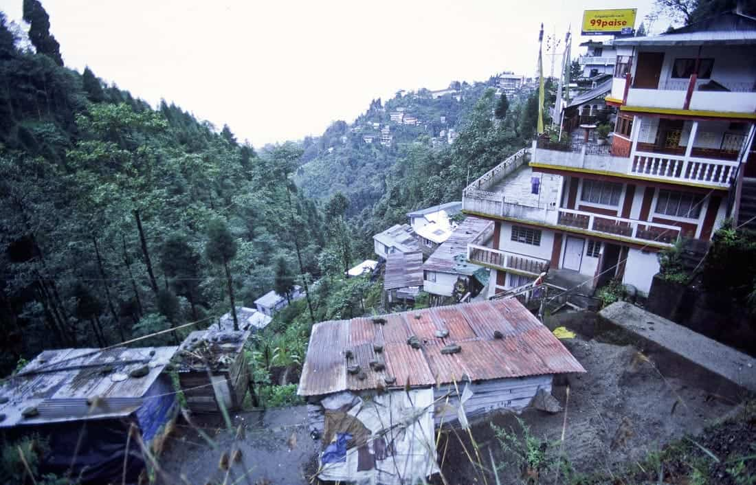 Houses spilling down the mountainside along Hill Cart Road, West Bengal, India