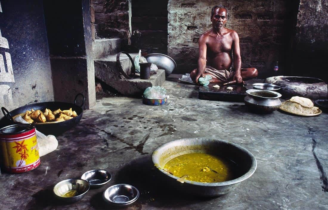 Man making samosas in a small village, West Bengal,India