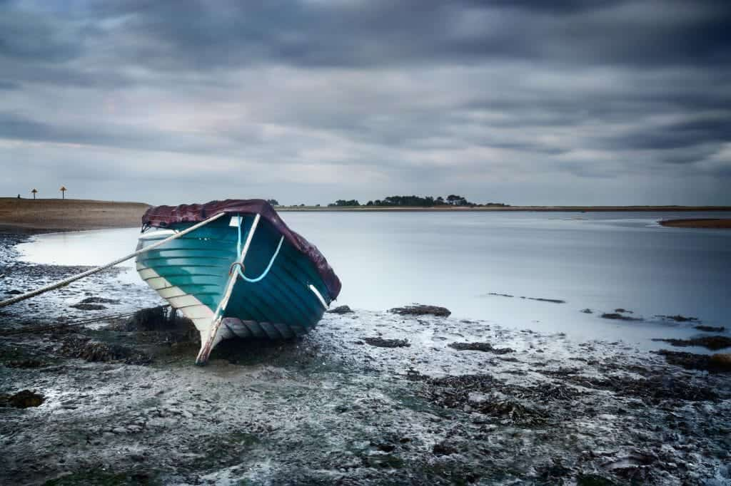 Boat at low tide, Wells-Next-The-Sea, Norfolk, England, UK