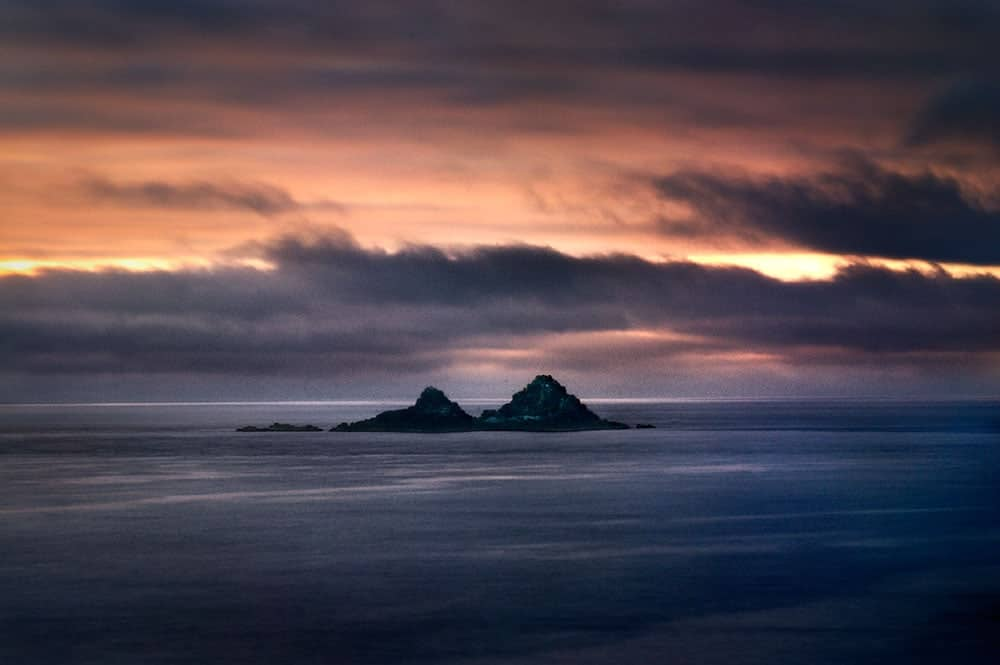 View across to the Brisons, two islands off the Atlantic coastline of Cornwall, England, UK
