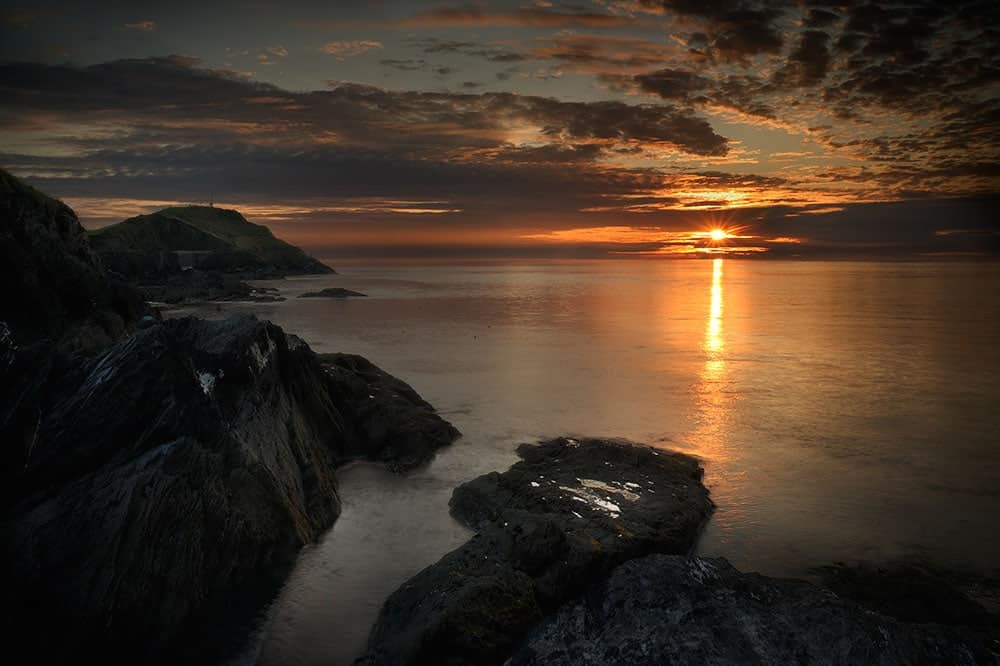 Watching the sun go down over ilfracombe, North Devon, England, UK