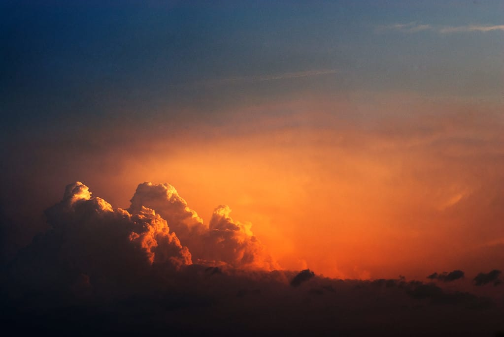 Cloud formation illuminated by the warm dawn light.