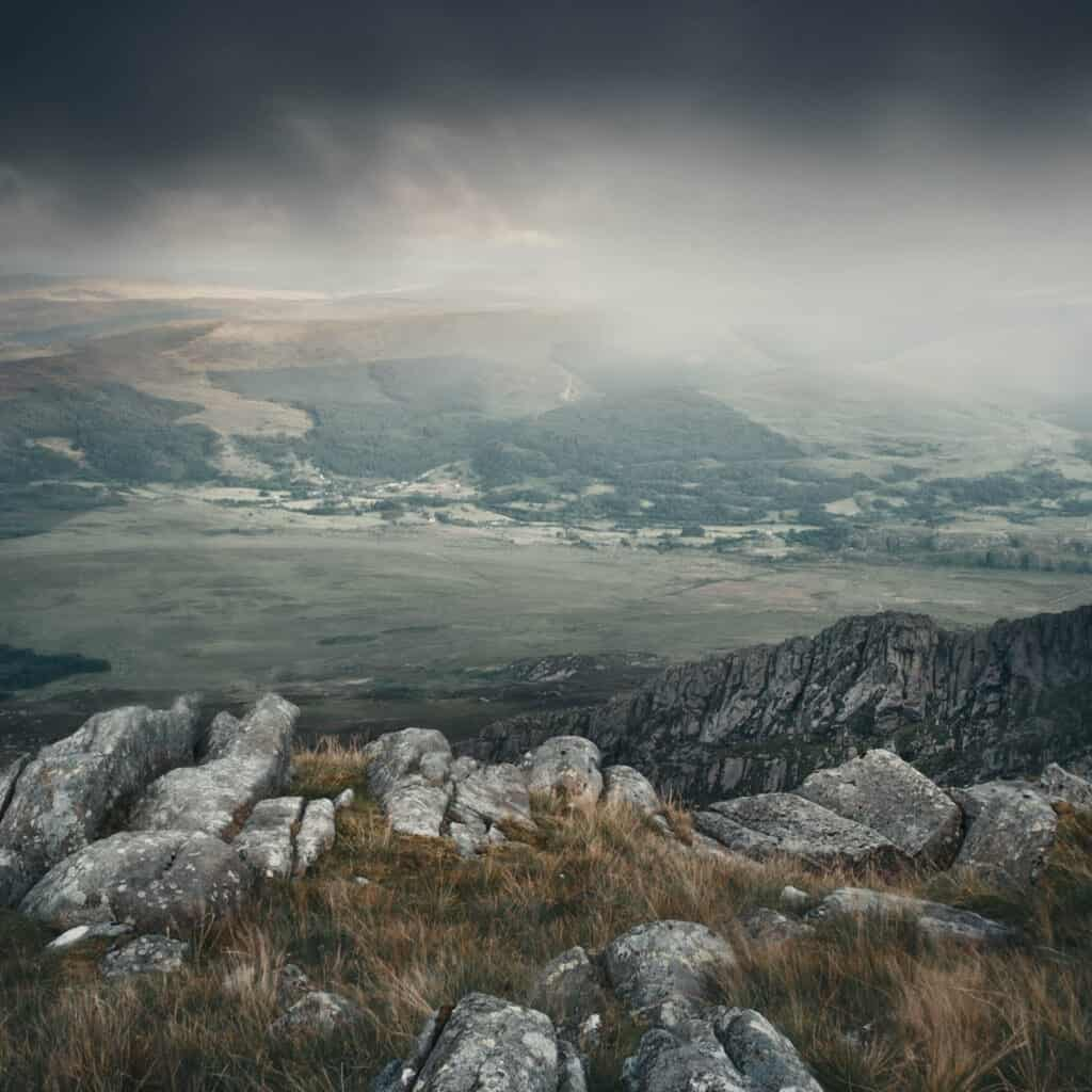 Landscape photography. Atmospheric clouds and rugged mountain scenery.