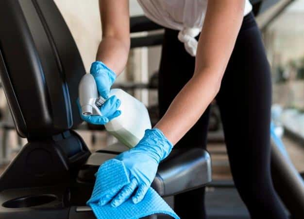 Woman with gloves cleaning seat