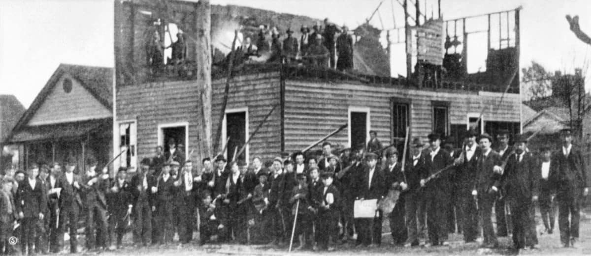 The mob standing in from of the ruins of The Daily Record, an African American paper, after the insurrection in Wilmington, North Carolina, on Nov. 10, 1898.