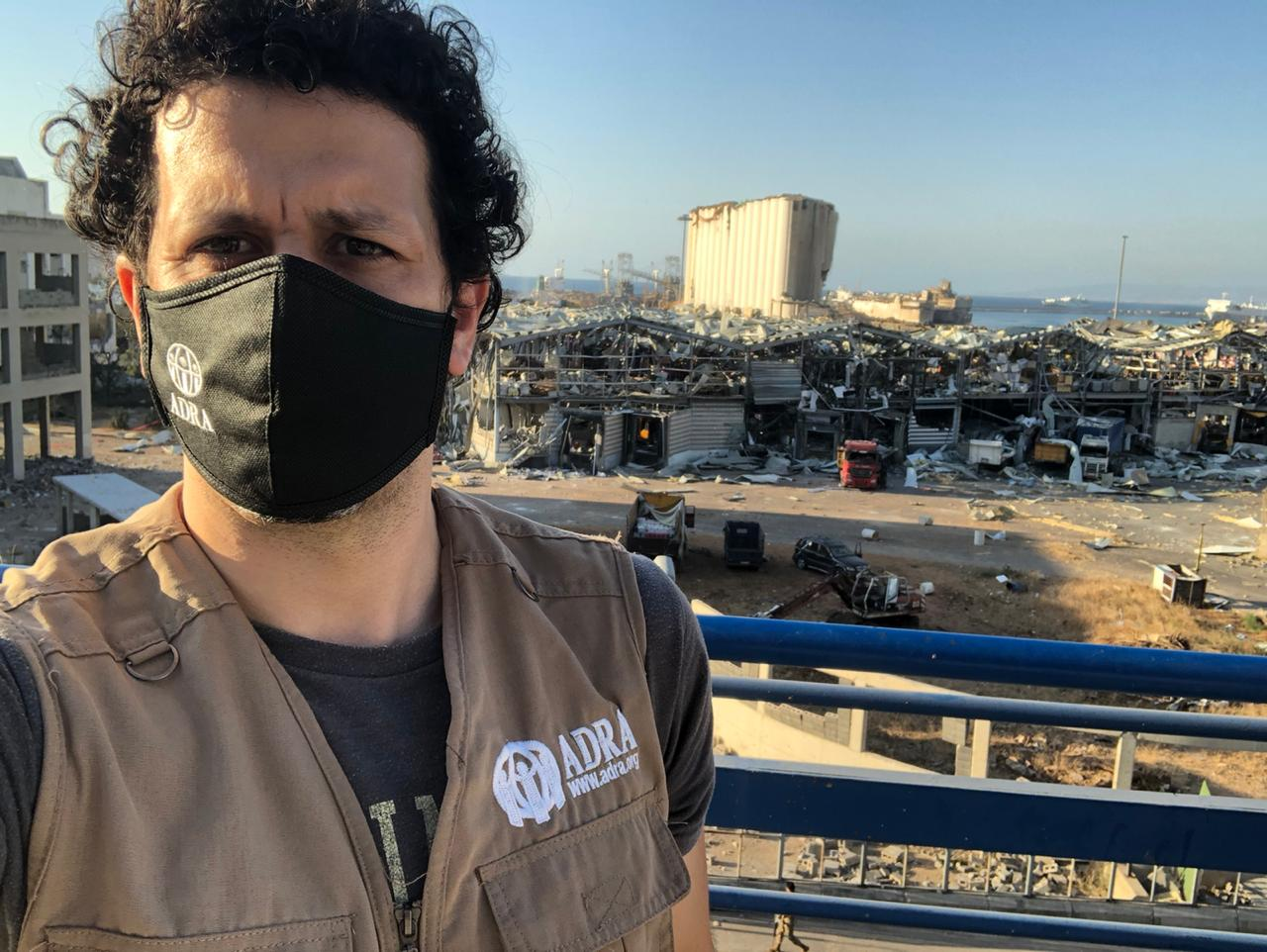ADRA worker takes a selfie showcasing the rubble left behind by a massive explosion, which decimated Beirut's port