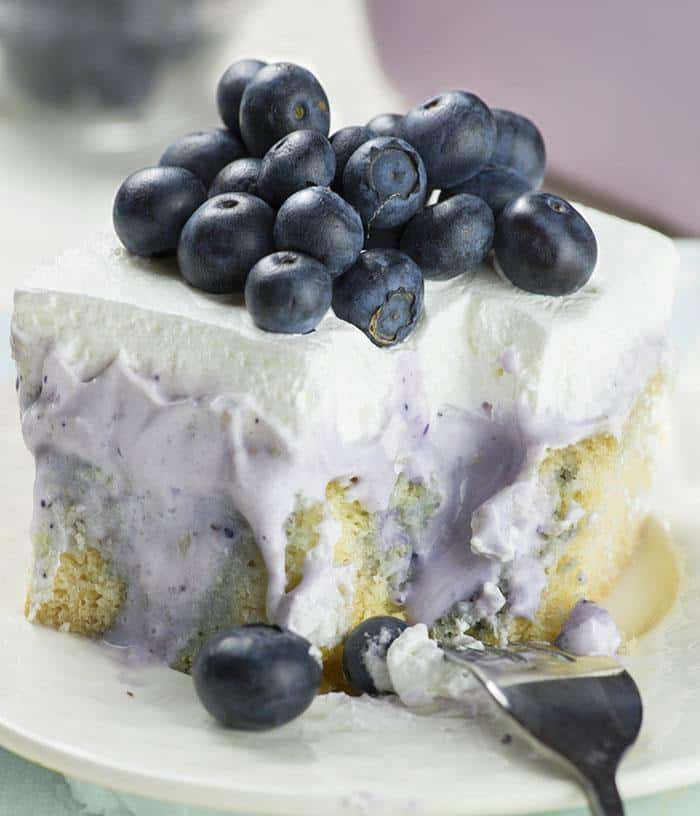 Blueberry Poke Cake is semi homemade dessert, simple and easy enough to make for any occasion, but also fancy enough to serve at special events.