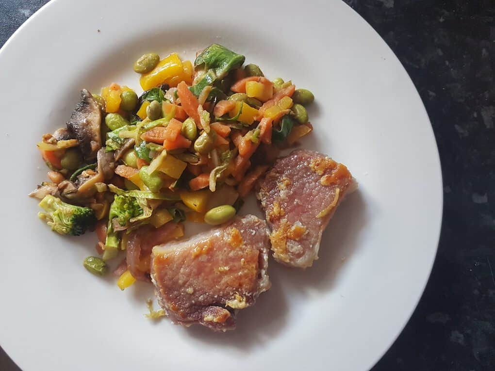 Pork chop with edemame stir fry vegetables