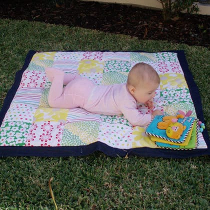 Your baby is likely to put some art of the mat in their mouth. - Best Play Mats for Hardwood Floors | Baby Journey