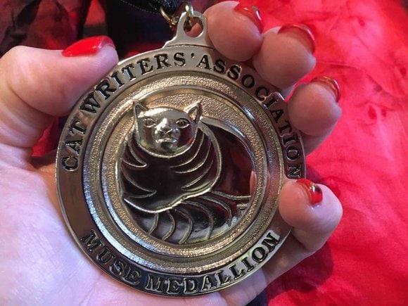 CWA Muse Medallion closeup