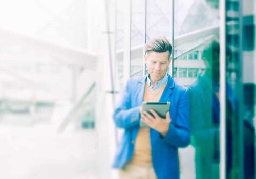 Corporate Lifestyle Man Outside London Office On iPad