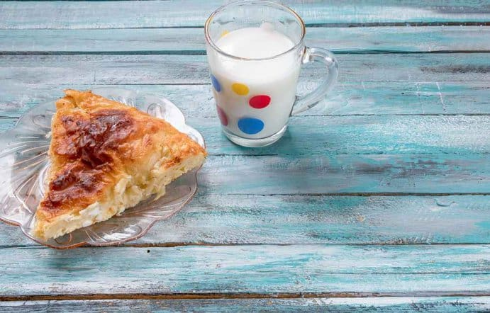 Croatia  - Traditional Bulgarian cheese pastry Banitsa on an wooden table with Greek yogurt
