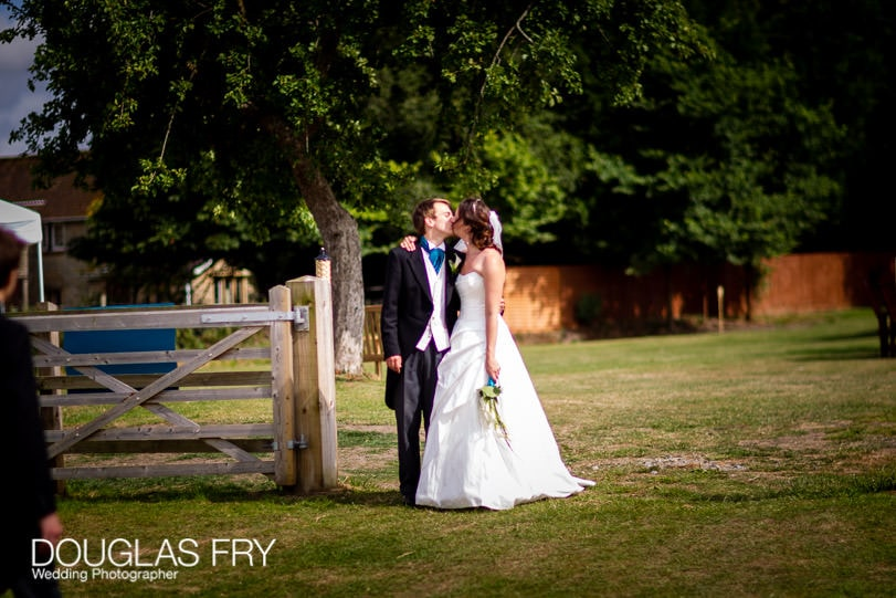 Bride and groom photographed kissing in Dorset