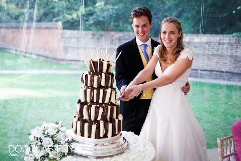wedding photograph of cake cutting in London