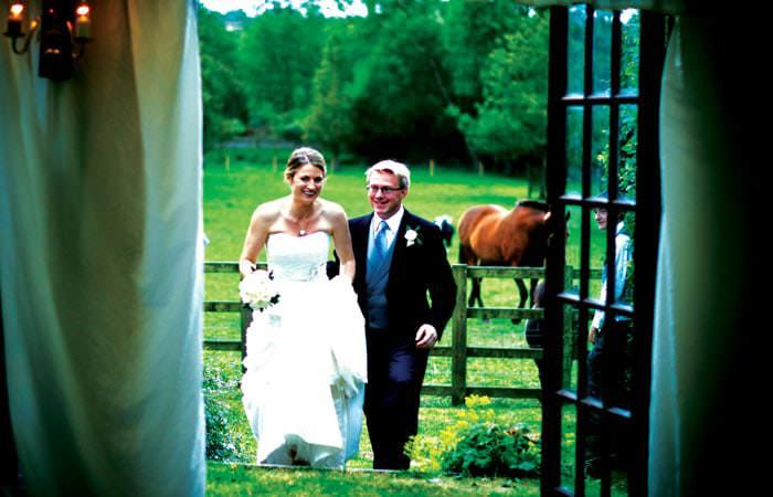 Wedding Photograph Bride and Groom entering Marquee