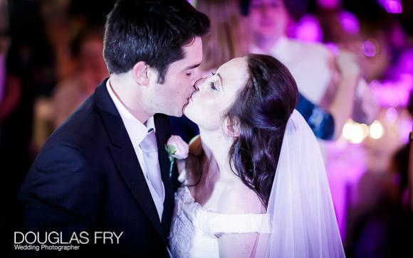 Wedding Photograph taken of kiss at Bluebird Chelsea