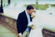 Wedding photograph of couple on embankment near Chelsea Old Church