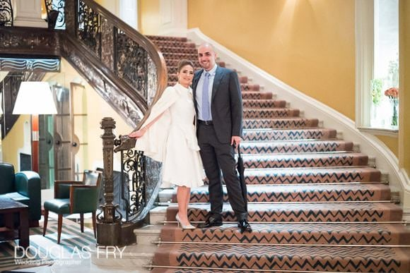 Couple on stairs in Claridges Hotel - Colour photograph